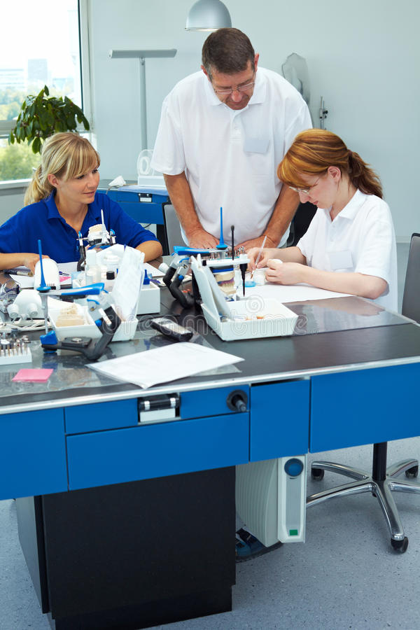 Dental staff in lab royalty free stock images
