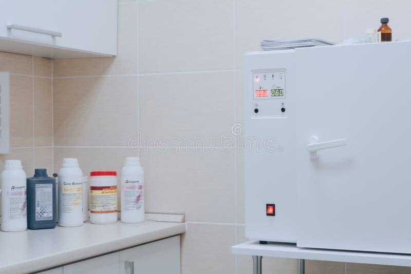 Dental sterilization room. Dentistry, medicine, medical equipment and stomatology concept. White tone stock image