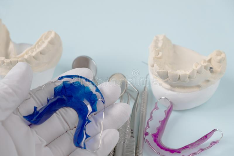 Dental tools and retainer. royalty free stock photography