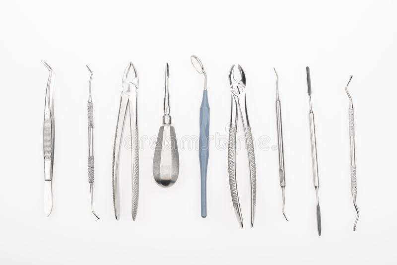 Dental tools. Top view of dental mirror and professional dentist tools isolated on white royalty free stock photos