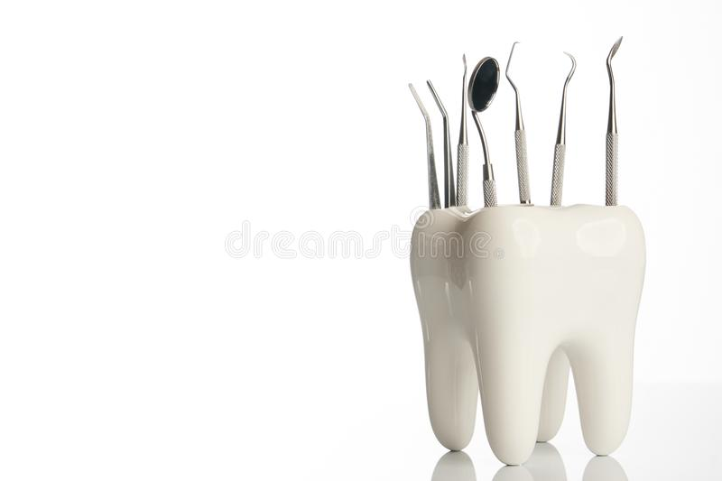Dental tooth model with metal medical dentistry equipment royalty free stock photos