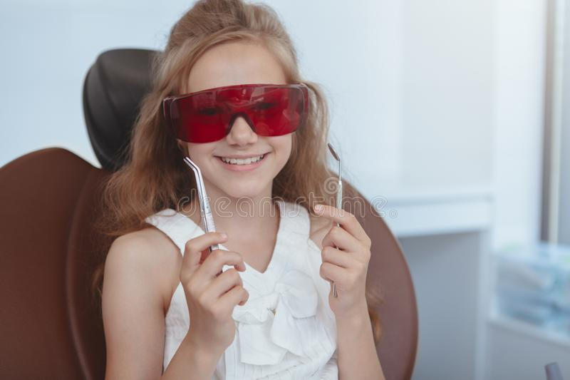 Beautiful young girl visiting dentist stock image
