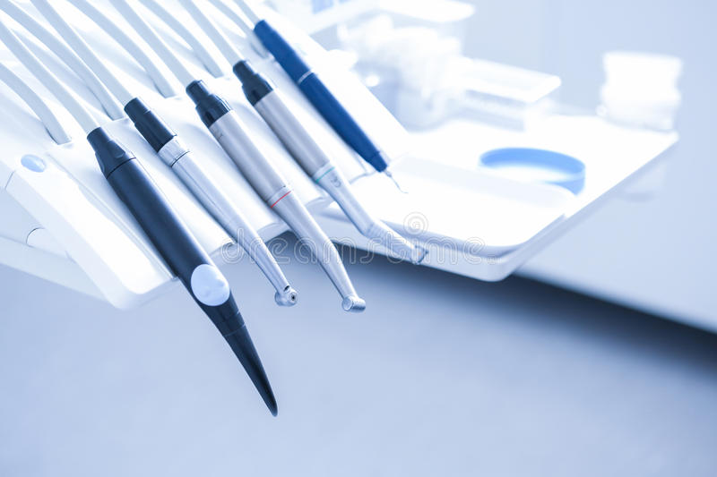 Dental treatment tools. Dental practice - specialist tools, drills, handpieces and laser royalty free stock photo