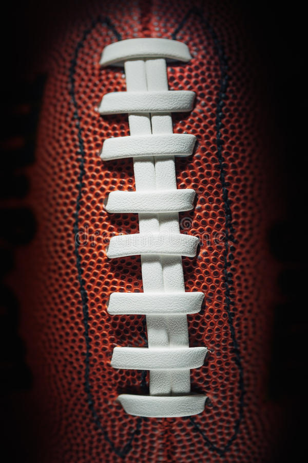 Dentelles et texture de football américain image stock