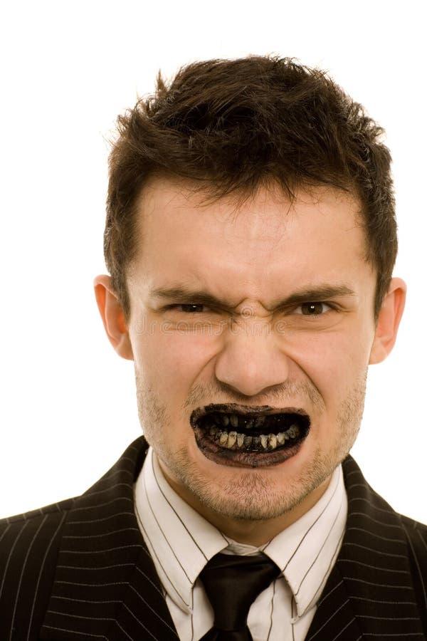 Dentes pretos fotografia de stock royalty free