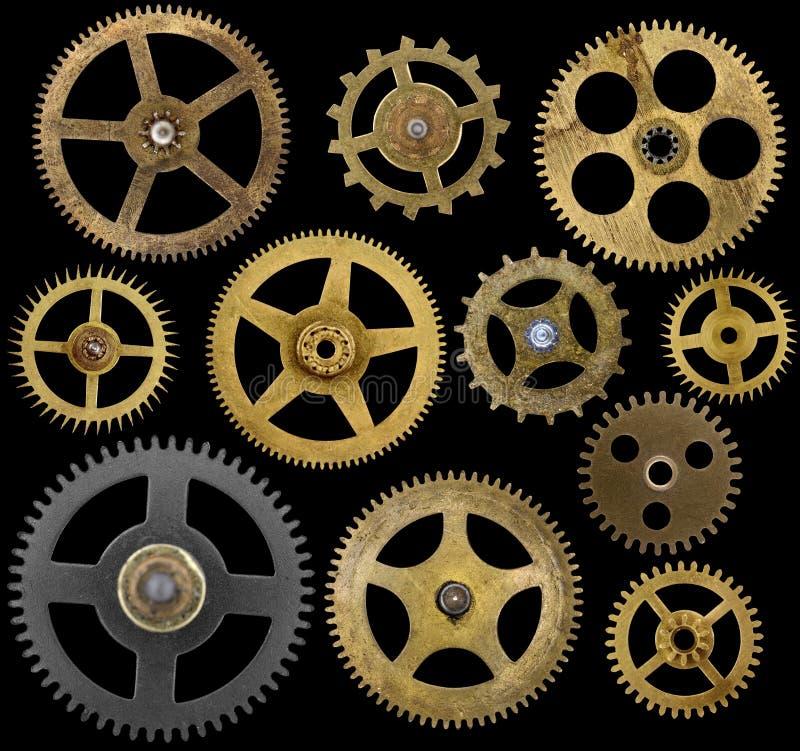 Denti dell'orologio isolati sul nero fotografia stock libera da diritti