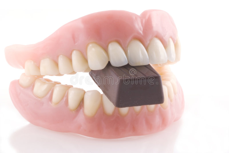 Dentiers et chocolat. images stock