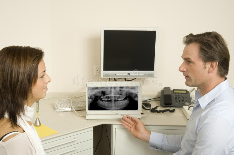 Dentist. A woman with the dentist royalty free stock images