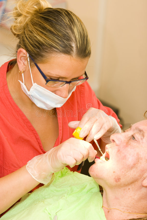 Dentist. Patient at the dentist in dental room royalty free stock photos