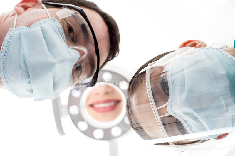 Dentist and assistant from low angle stock photography