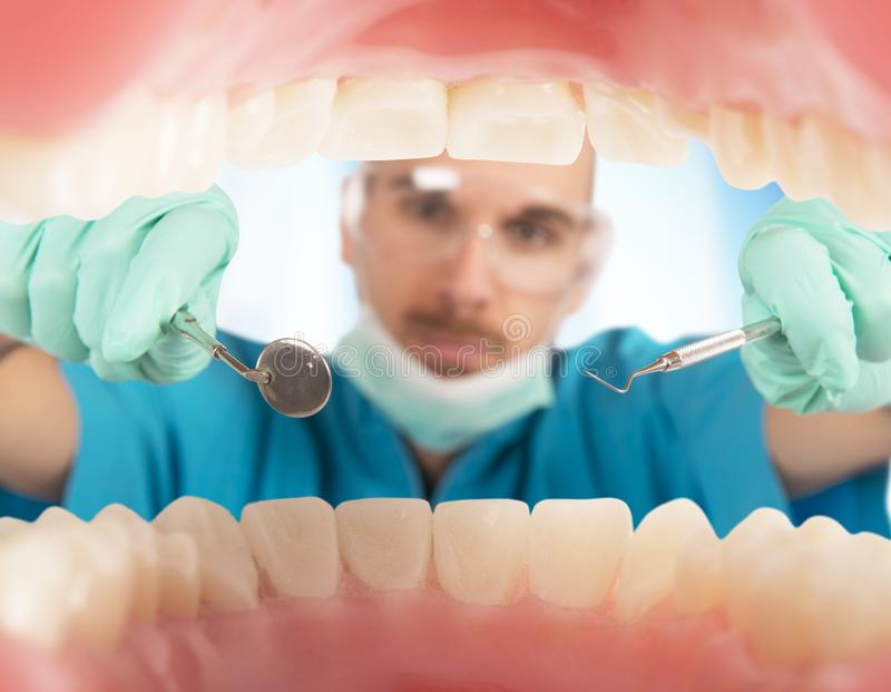 Dentist check. S the teeth of a patient royalty free stock images