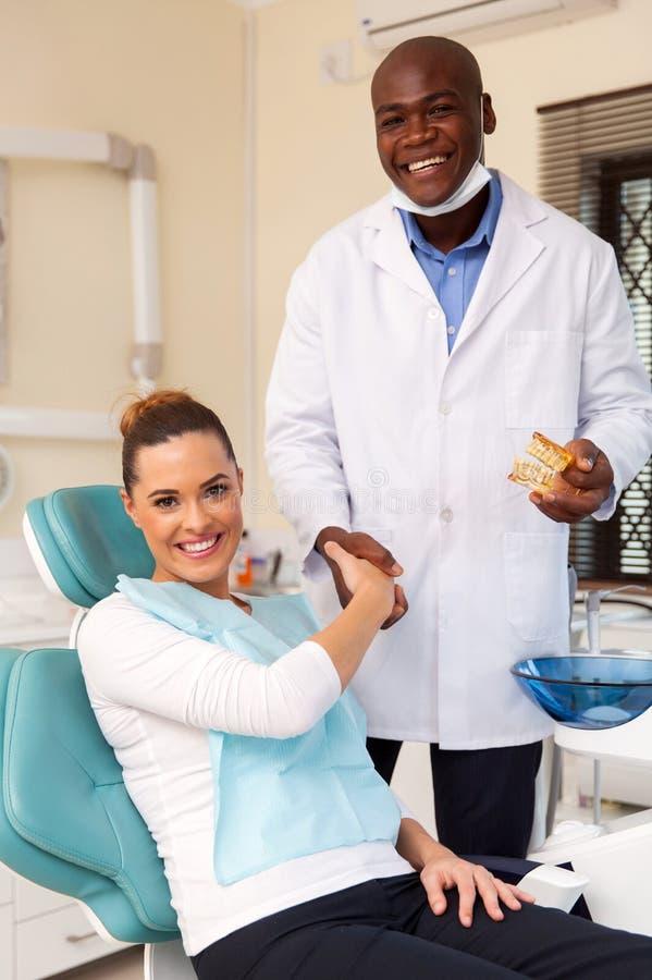 Dentist congratulate patient stock photo