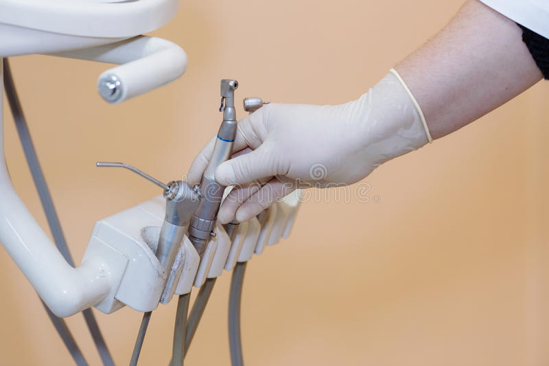 Dentist doctor hand holding medical tools in dental office. Concept of healthy stock photos