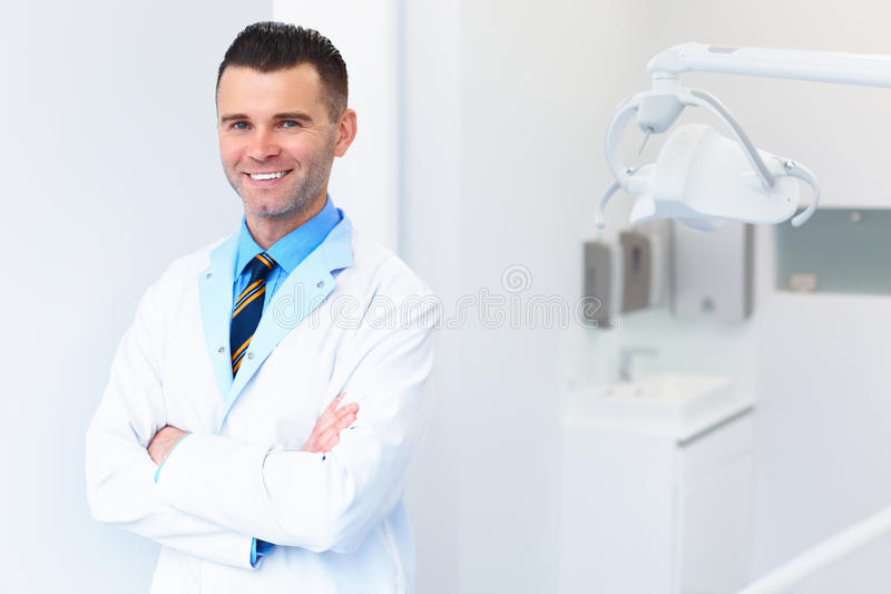 Dentist Doctor Portrait. Young Man at His Workplace. Dental Clin royalty free stock image
