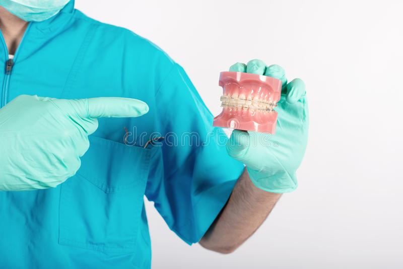 Dentist shows how to apply a brace stock photos