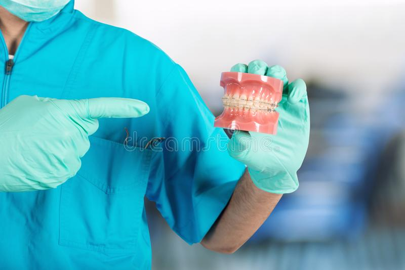 Dentist shows how to apply a brace royalty free stock images