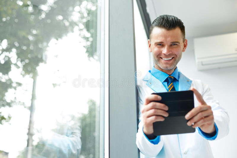 Dentist Doctor Takes Photo Using His Smartphone. Doctor Has Some fun royalty free stock photos
