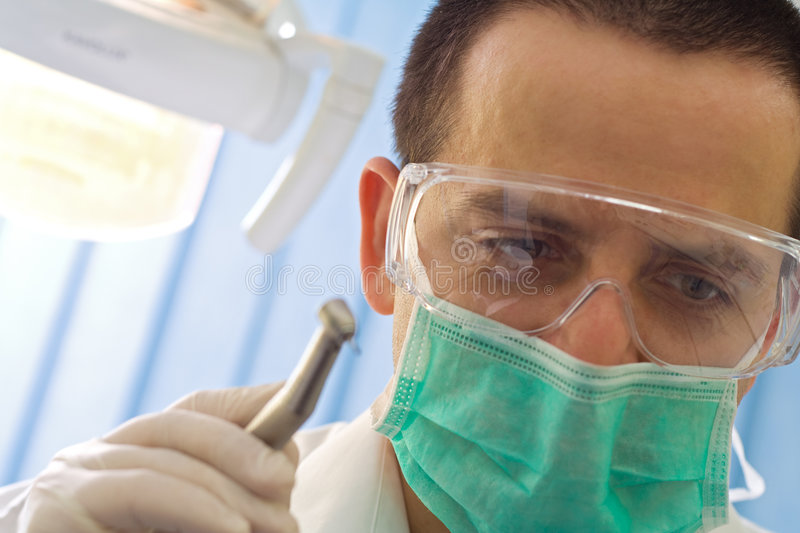 Dentist with drill - closeup stock photo