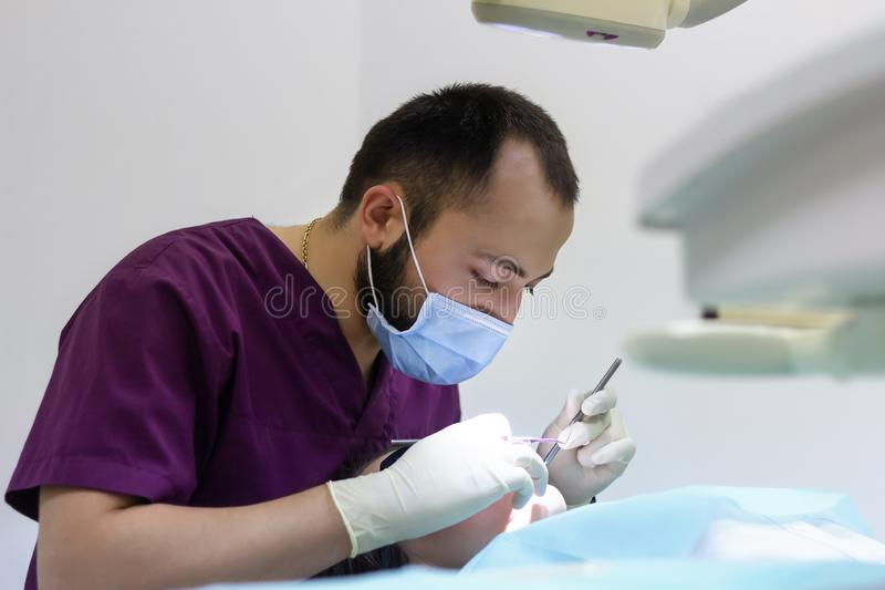 Dentist examines a  woman patient working explaining   healthy. Dentist examines a  women patient working explaining   healthy work royalty free stock photography