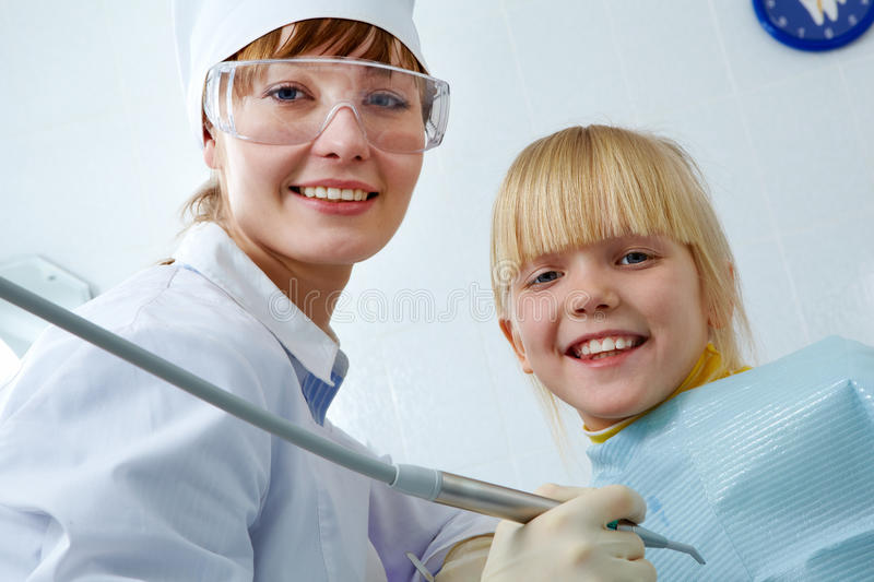 Dentist and girl royalty free stock photo