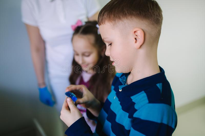 Dentist give a toy for little patient, happy children get a present royalty free stock image