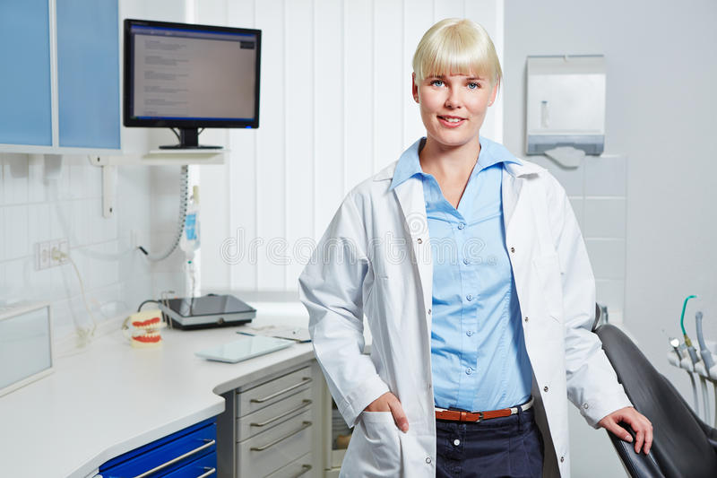 Dentist in her dental practice stock images