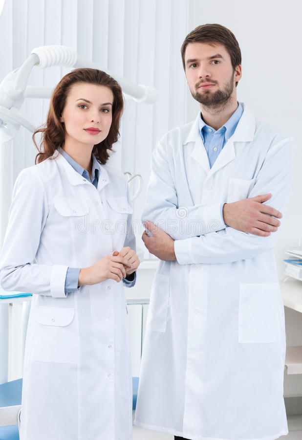 Dentist And His Assistant Stock Photos