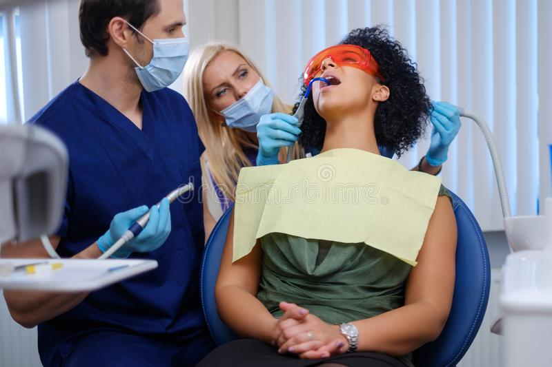 Dentist and his assitant working in private practice royalty free stock photos