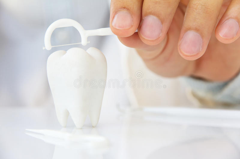 Flossing teeth concept stock photography