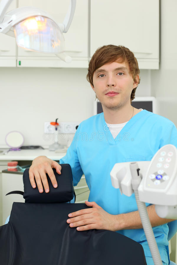 Download Dentist Looks At Camera In Dental Clinic Stock Photography - Image: 26337772