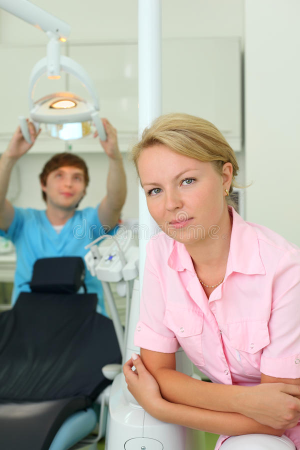 Download Dentist Looks At Camera In Dental Clinic Stock Photo - Image: 26337774