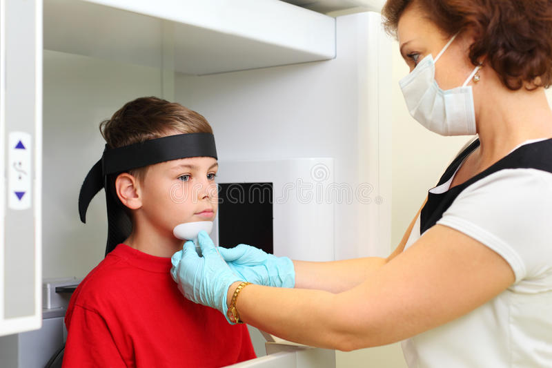 Download Dentist In Mask Prepares Boy To Jaw X-ray Image Stock Photo - Image: 26337668