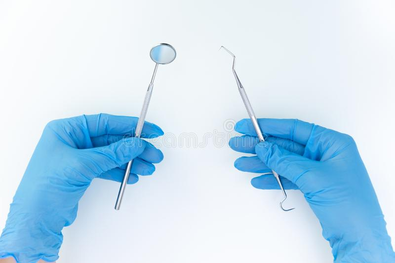 Dentist in medical gloves working with professional stomatology tools . Dental hygiene and health concept royalty free stock photography