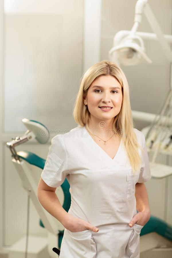 Dentist office. A doctor inside of a dentist cabinet full of medical equipment.  stock photos