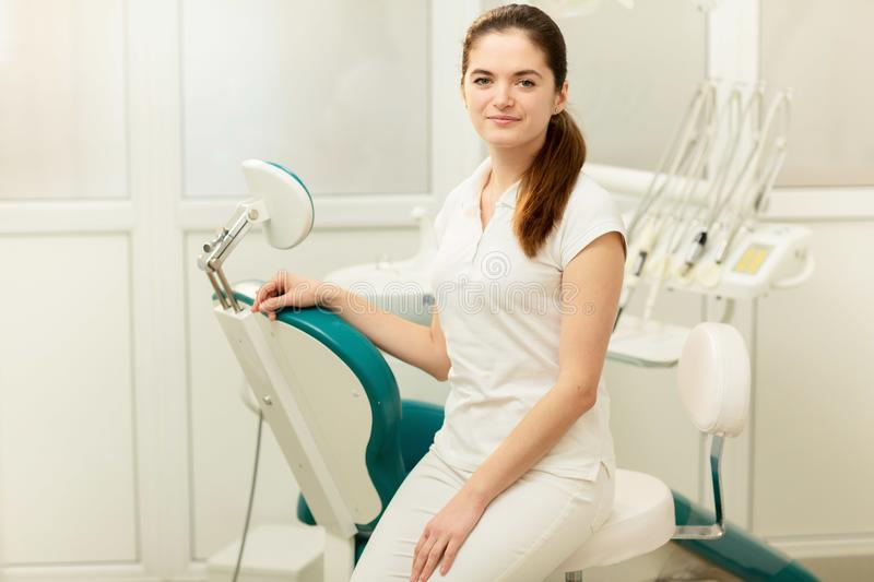 Dentist office. A doctor inside of a dentist cabinet full of medical equipment.  royalty free stock photo