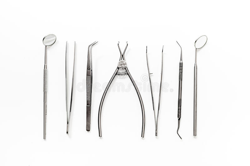 Dentist office with tools for teeth care on white background top view royalty free stock photos