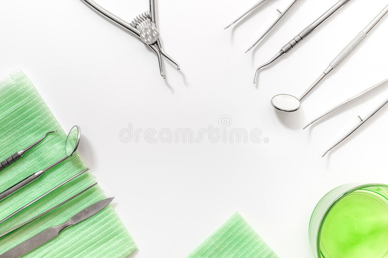 Dentist office with tools for teeth care on white background top view mock up stock photo