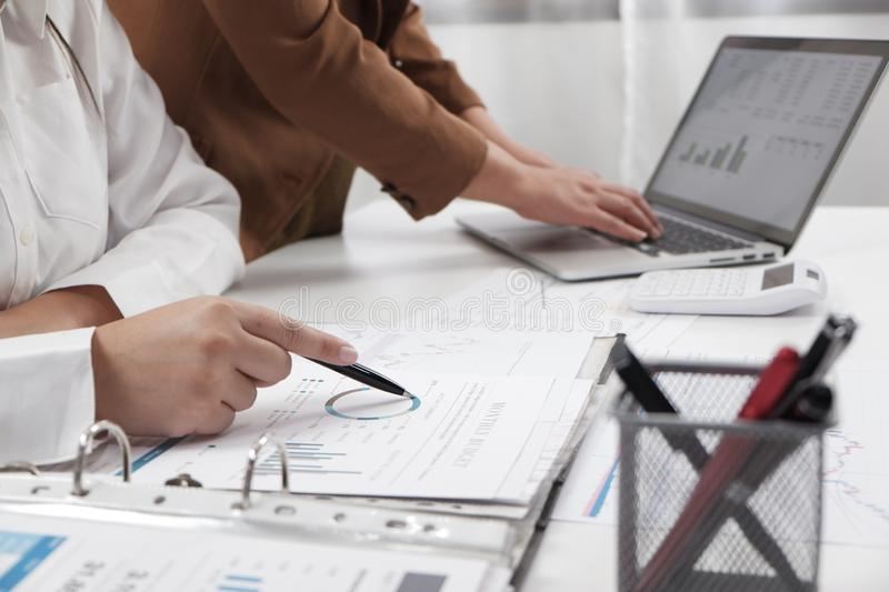 Businesswomen working together in office teamwork brainstorming accounting business concept stock photo