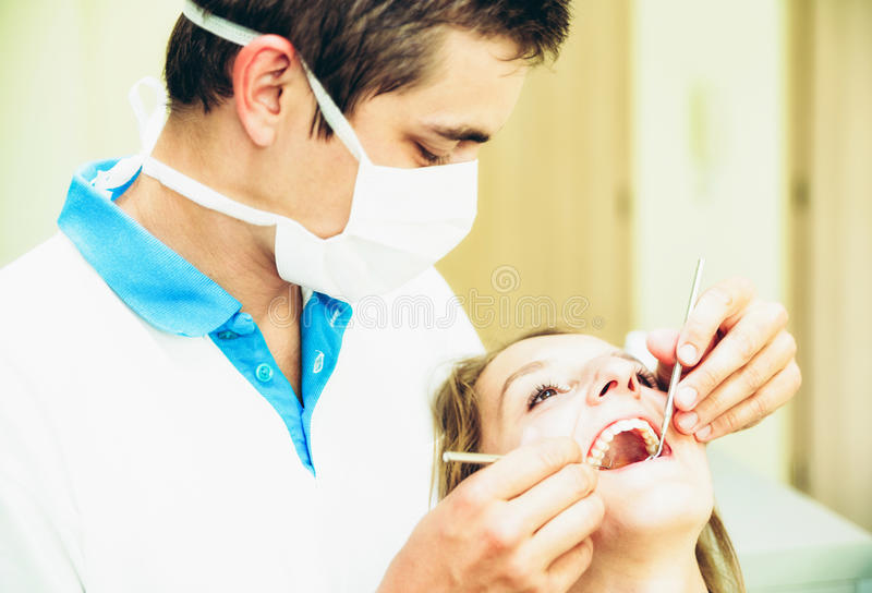 Dentist and patient stock images
