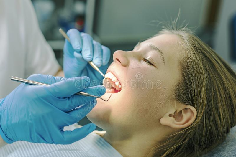 The dentist and the patient. stock images