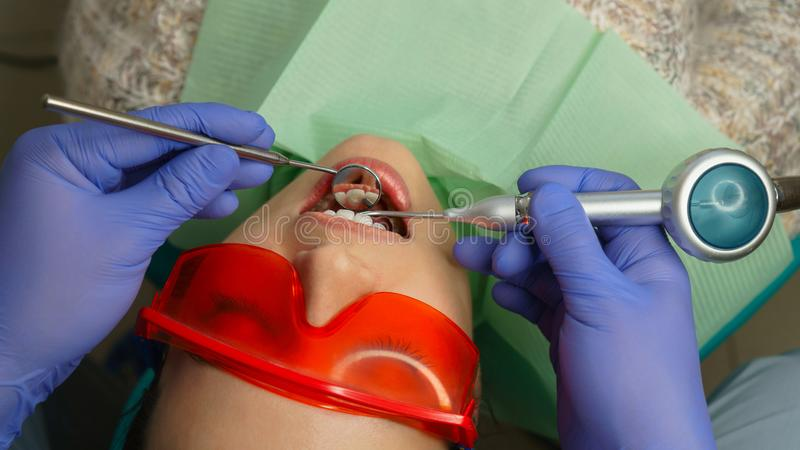 Girl patient in dental clinic stock image