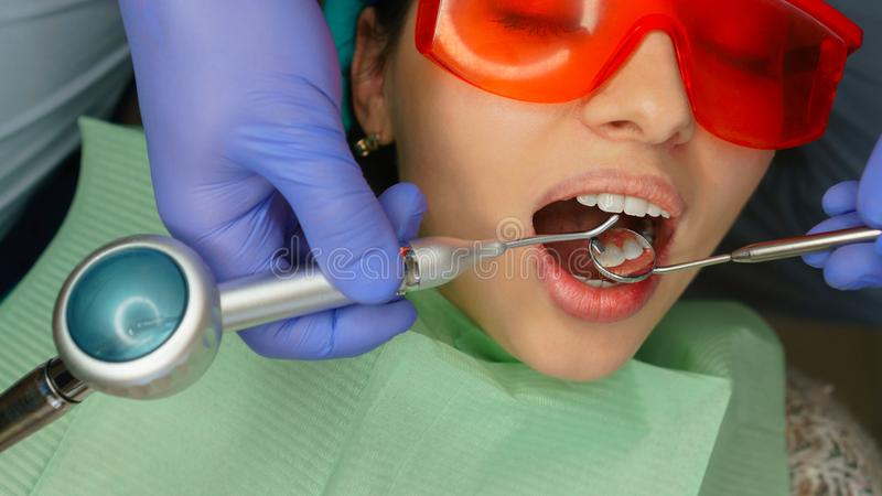 Girl patient in dental clinic stock images