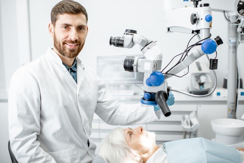 Dentist`s portrait with a microscope royalty free stock photos