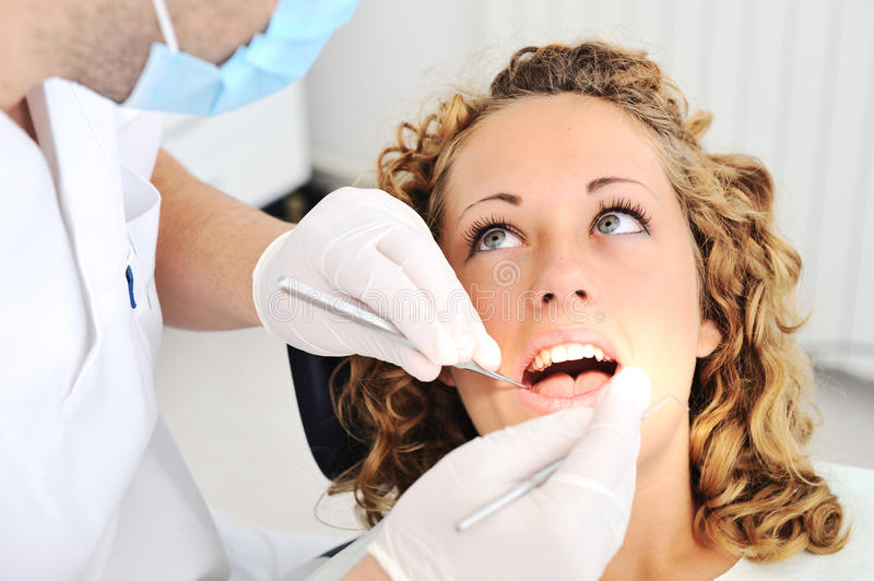 Dentist's teeth checkup stock image