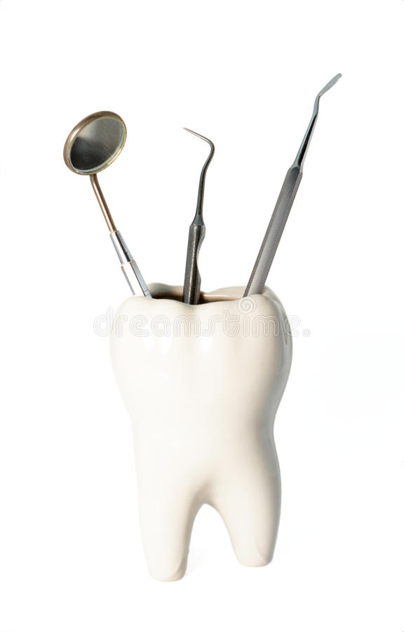 Dentist tool. With tooth isolated on white background stock images