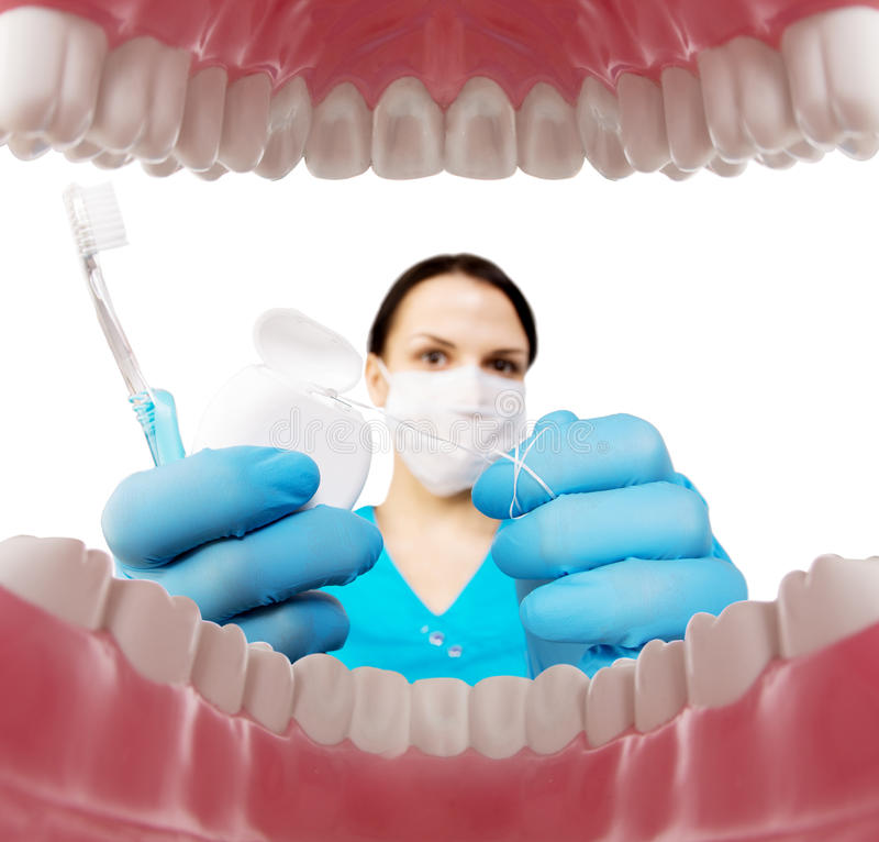 Dentist with tools. Concept of dentistry, whitening, oral hygiene, teeth cleaning with toothbrush, floss. Dentistry, taking care royalty free stock images