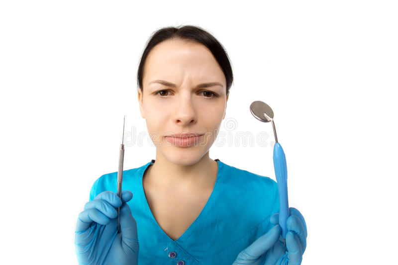Dentist with tools. Concept of dentistry, whitening, oral hygiene, teeth cleaning with toothbrush, floss. Dentistry, taking care royalty free stock photography