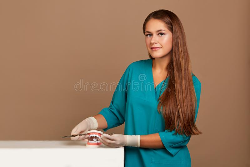 Dentist with tools. Concept of dentistry, whitening, oral hygiene, teeth cleaning with toothbrush, floss. Dentistry stock photos