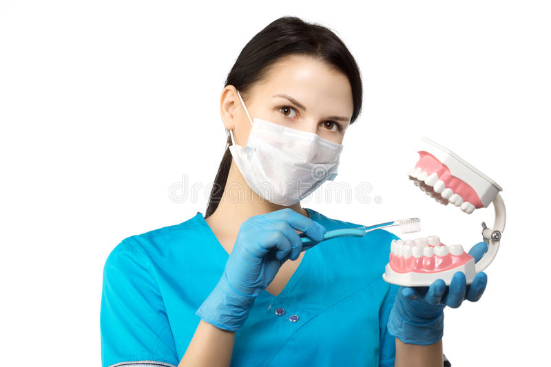 Dentist with tools. Dentist. The concept of dentistry, whitening stock photography