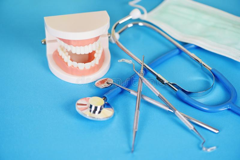 Dentist tools with dentures dentistry instruments and dental hygienist checkup concept with teeth model and mouth mirror oral. Health and stethoscope doctor stock photography